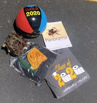 Senior gifts: beach ball, tshirt, cap & gown, magazine
